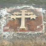 The place on the bridge parapet where St. John of Nepomuk was thrown into the Vltava river after refusing to violate the Seal of Confession.